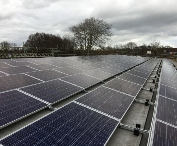 Solar panels on the rooftop of Brookside Primary School, owned and managed by Low Carbon Hub