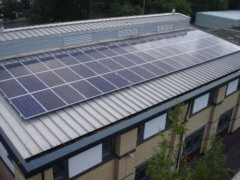 Solar panels on the rooftop of Cheney School, owned and managed by Low Carbon Hub