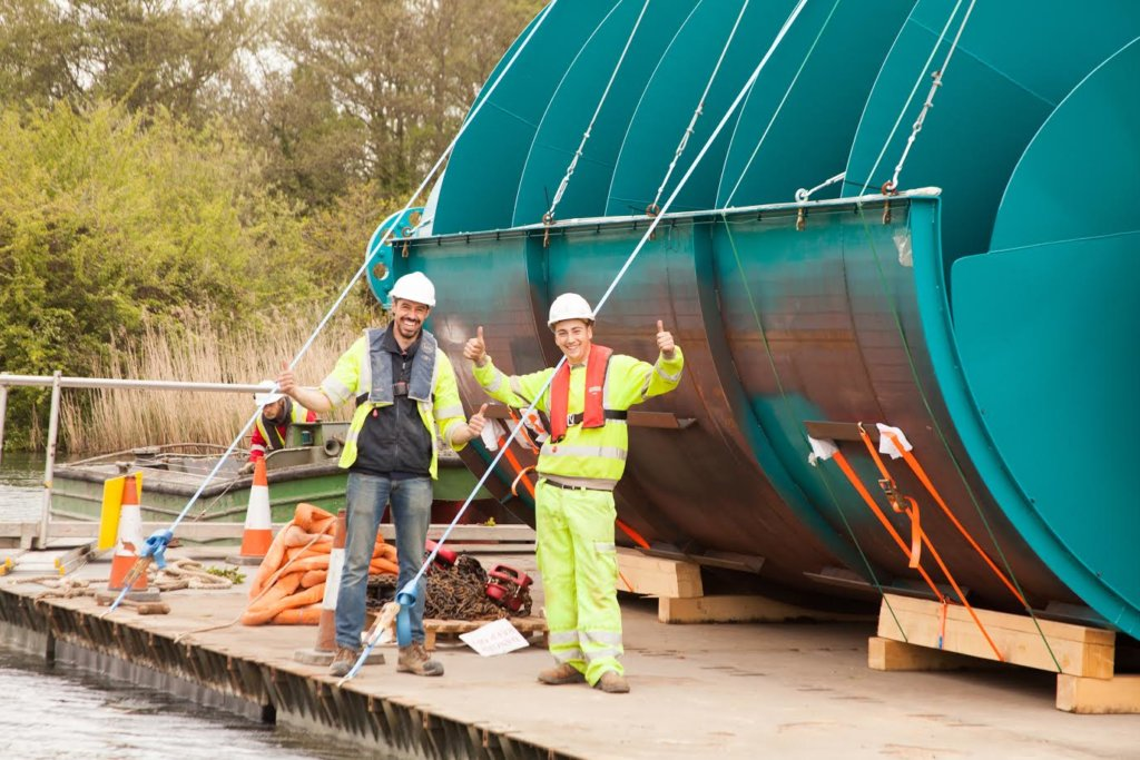 Sandford Hydro construction - the Archimedes screws being floated along the river