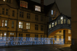 Words made out of light under the Bridge of Sighs in Oxford: Community energy can power a low carbon economy.