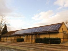Solar panels on the rooftop of Cherwell School, owned and managed by Low Carbon Hub
