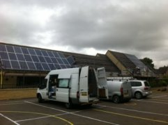 Solar panels on the rooftop of Stonesfield Primary School, owned and managed by Low Carbon Hub