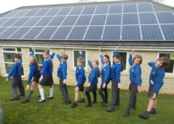 Solar panels on the rooftop of Middle Barton School, owned and managed by Low Carbon Hub
