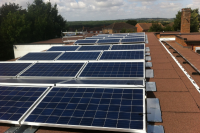 Solar panels on the rooftop of Rose Hill School, owned and managed by Low Carbon Hub