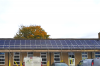 Solar panels on the rooftop of Sonning Common School, owned and managed by Low Carbon Hub