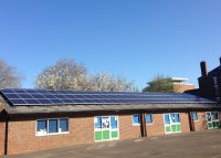 Solar panels on the rooftop of St Barnabus School, owned and managed by Low Carbon Hub