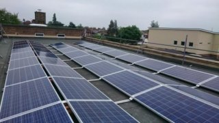 Solar panels on the rooftop of Windmill School, owned and managed by Low Carbon Hub