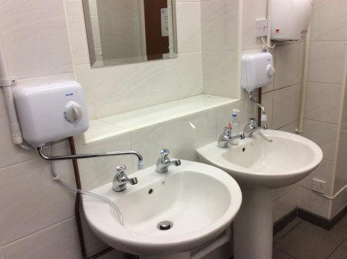 Installing water heaters at Kirtlington Village Hall